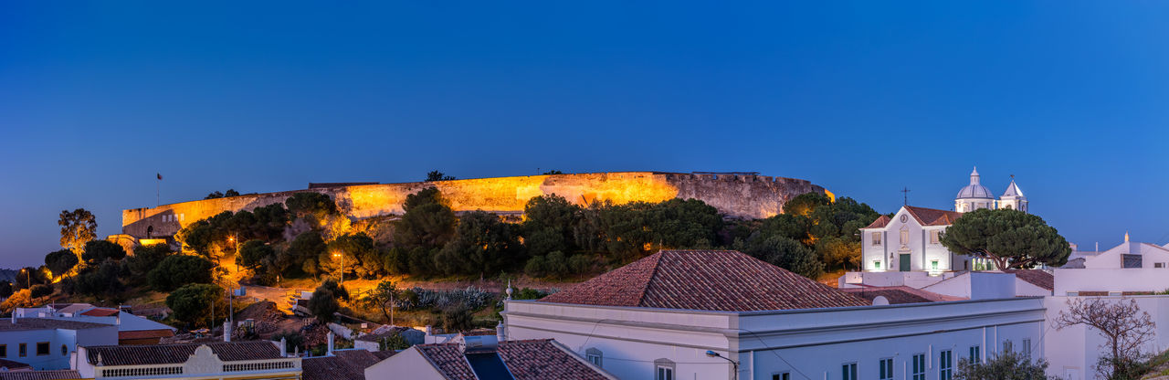Castle of Castro Marim, Algarve, at sunset Portugal Algarve Castro Marim Panorama Panoramic Castle Castelo Lights Luzes Anoitecer Clear Sky Summer Warm Night House Roof High Angle View Vantage Point Scenics Turismo Feria Verão Vacations Historic King Church