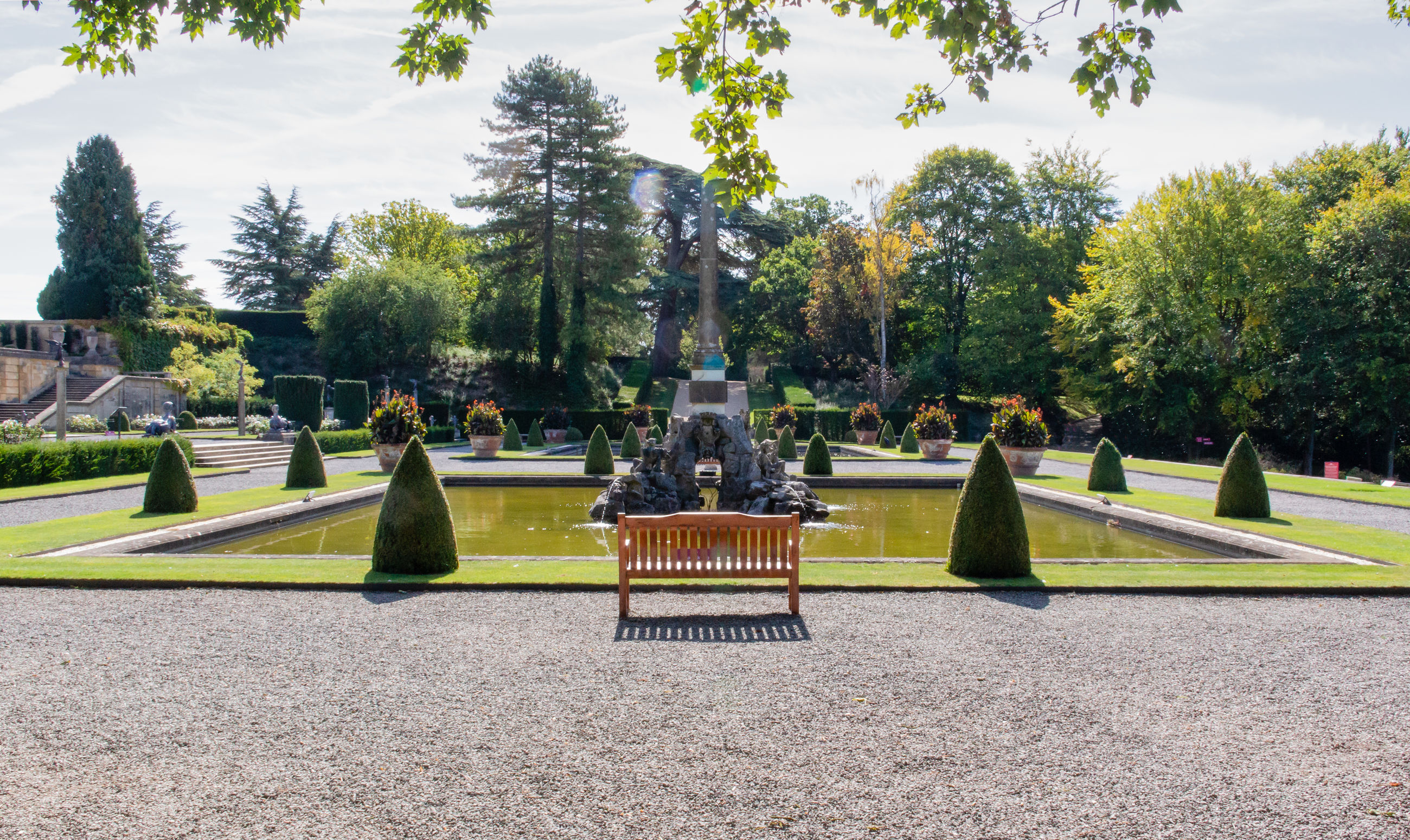 tree, plant, nature, day, park, sky, park - man made space, grass, growth, green color, architecture, outdoors, sculpture, no people, tranquility, beauty in nature, sunlight, garden, statue, history
