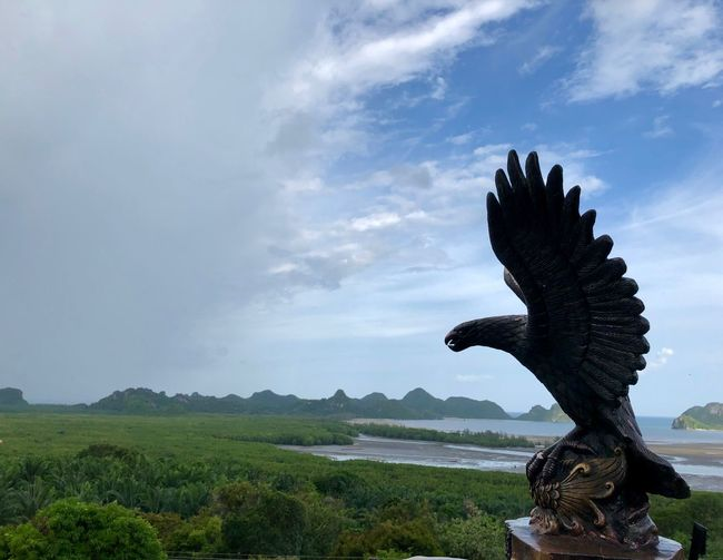 View of statue on landscape against sky