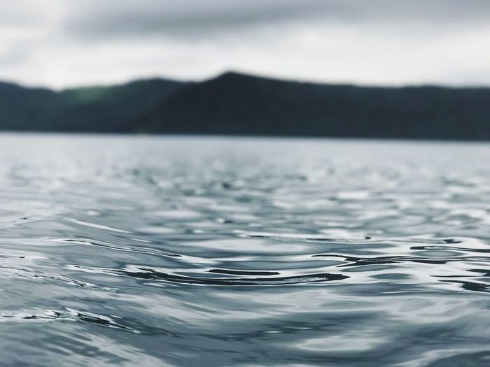 Close-up of rippled water against sky