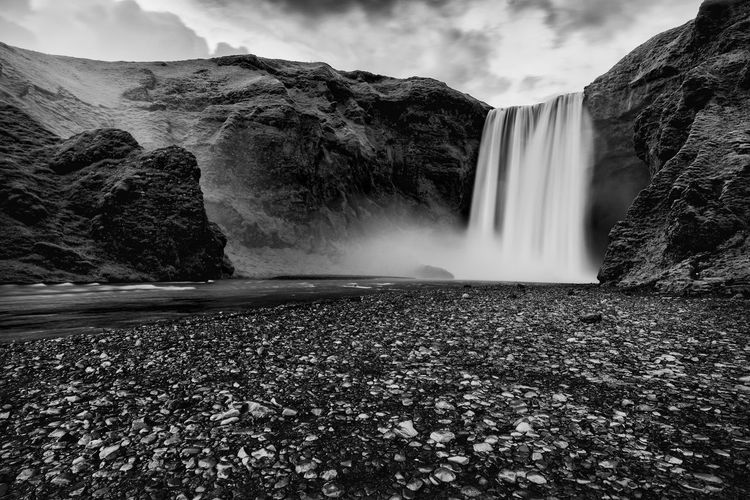 Skogafoss Waterfall Iceland Travel Beauty In Nature Black And White Cliff Day Landmark Landscape Long Exposure Motion Mountain Nature No People Outdoors Power In Nature Rock - Object Rock Formation Scenics Skogafoss Sky Tourism Travel Destinations Water Waterfall Wide