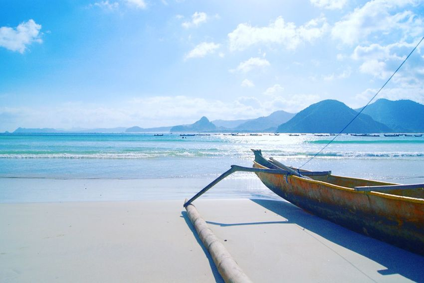 Water Sky Scenics Tranquil Scene Beauty In Nature Nature Tranquility Sea Transportation Day Mountain Outdoors Nautical Vessel No People Cloud - Sky Mode Of Transport Beach Moored Horizon Over Water Outrigger