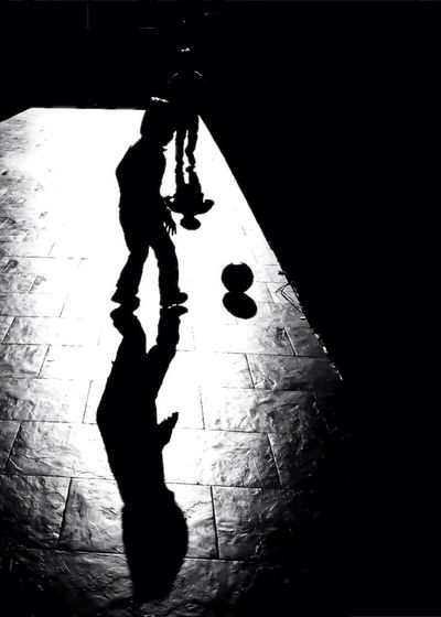 Silhouette man and woman climbing on floor