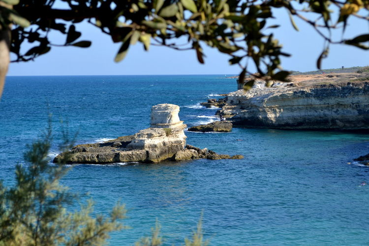 Puglia Architecture Beauty In Nature Blue Building Exterior Built Structure Clear Sky Cliff Day Foreground History Horizon Over Water Nature No People Outdoors Rock - Object Salento Scenics Sea Sky Tranquil Scene Tranquility Travel Destinations Tree Water