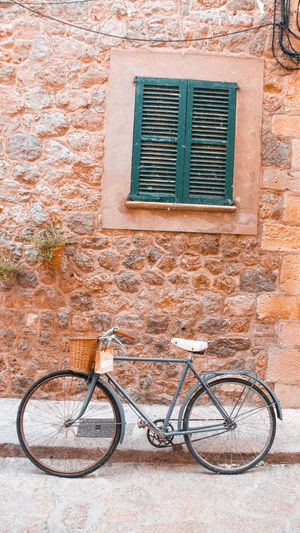 SIMPLICITY Islandlife Spanish Culture Share Like Tranportation Transport Forest Nature Bike Followme Love Extirior Esteripr Decoration Minimalist Simplicity Europe SPAIN Mallorca Mountain Village Window Bicycle Architecture No People Outdoors Old-fashioned Day Summer Building Exterior