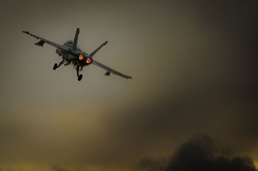 Lone F-18 Hornet roars off into the sky Aeroplane Afterburner Aircraft Alone F18 Fighter Flying Goodbyw Hornet Jet Mid-air Moody On The Move Plane Selective Focus Sky Storm TakeOff Unknown US MARINES