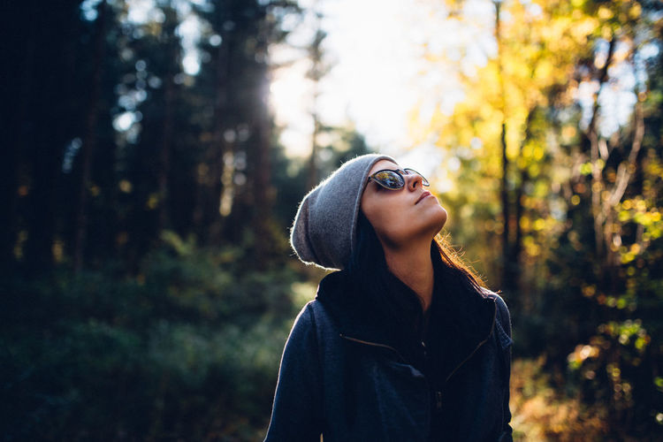 Woman In Sunglasses In Forest