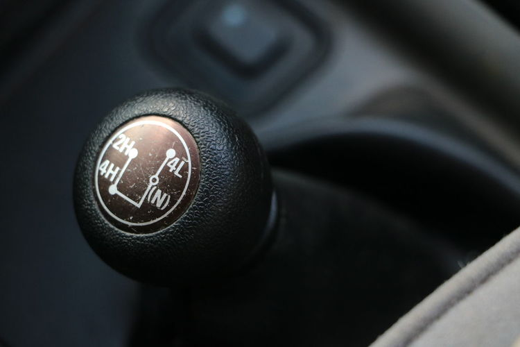 4x4 4x4wd Gear Shift Gearshift Car Interior Vehicle Car Motor Vehicle Close-up Mode Of Transportation Indoors  Transportation Number Vehicle Interior No People Text Control Land Vehicle Focus On Foreground Technology Communication Western Script Black Color Speed