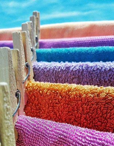 Detail Shot Of Pegs On Towels
