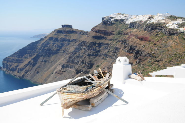 Santorini, best view. Greece island full of Volcano. Beauty In Nature Bia Blue Cloud Day Greece Green Landscape Mountain Mountain Range Nature No People Non-urban Scene Old Boat Outdoors Remote Rock Formation Santorini Scenics Sky Tourism Tranquil Scene Tranquility Travel Destinations Vessel