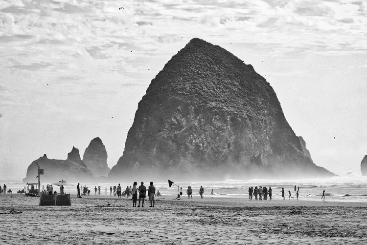 Haystack Rock Land Beach Water Sky Group Of People Sea Nature Crowd Beauty In Nature Mountain Large Group Of People Rock Real People Sand Rock Formation Rock - Object Day Scenics - Nature Travel Destinations Outdoors