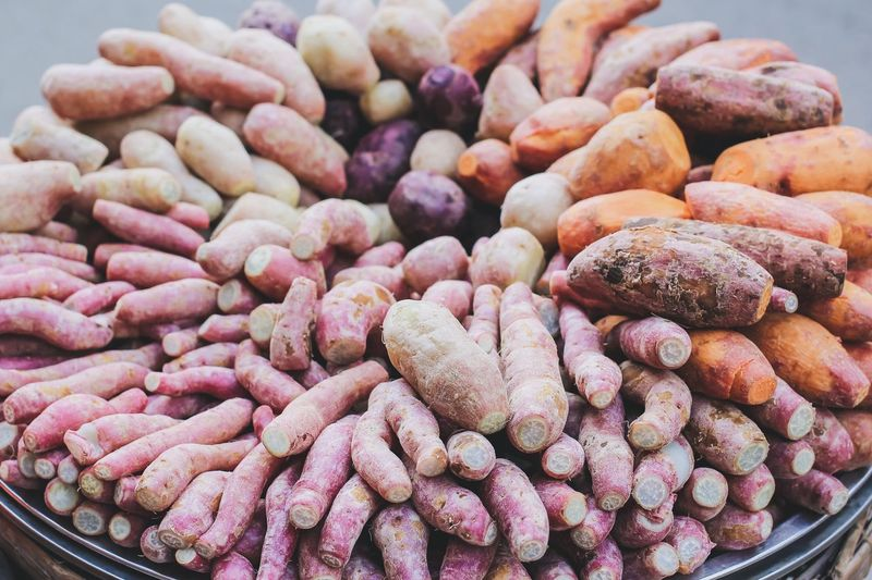 Close-up of sweet potatoes for sale at market stall
