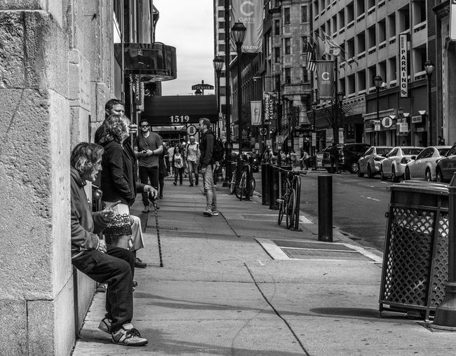 can you spare some change Architecture Building Building Exterior Built Structure Casual Clothing City City Life City Street Day Full Length Leisure Activity Lifestyles Outdoors Panhandling The Way Forward The Street Photographer - 2016 EyeEm Awards