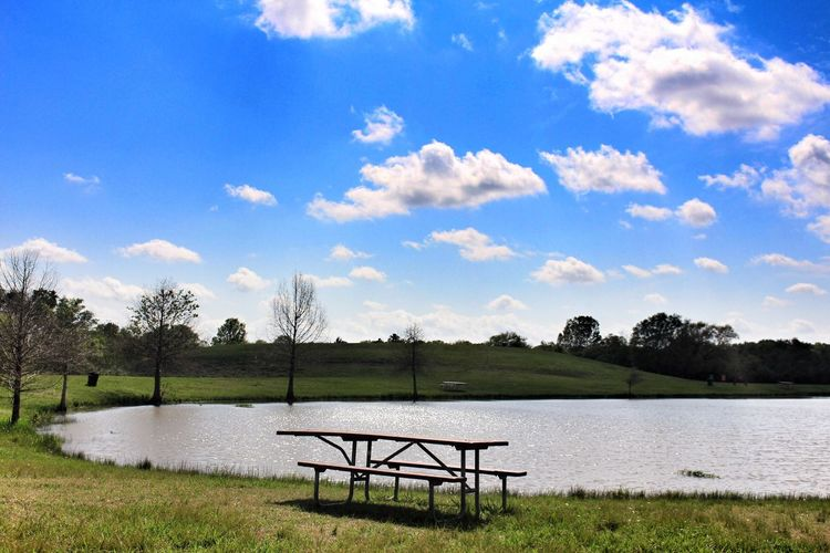 It really has been a beautiful weekend. Ready to worship tomorrow. Lots of music and ministry. Here is a shot from Challenger park. ➖➖➖➖➖➖➖➖➖➖➖ #clouds #pond #bluesky #picnictable