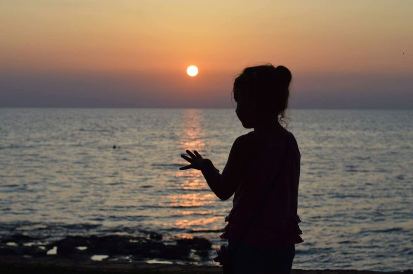 Sunset Sea One Person Beach Water Horizon Over Water Sky Outdoors Nature Beauty In Nature