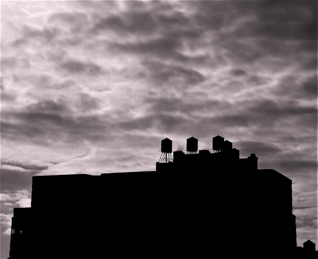 NYC BW Sil Architecture Building Exterior Built Structure Silhouette Cloud - Sky Low Angle View Outdoors No People Sky Day Nature NYC USA Sunset Clouds Be. Ready. Black And White Friday Black And White Friday The Graphic City