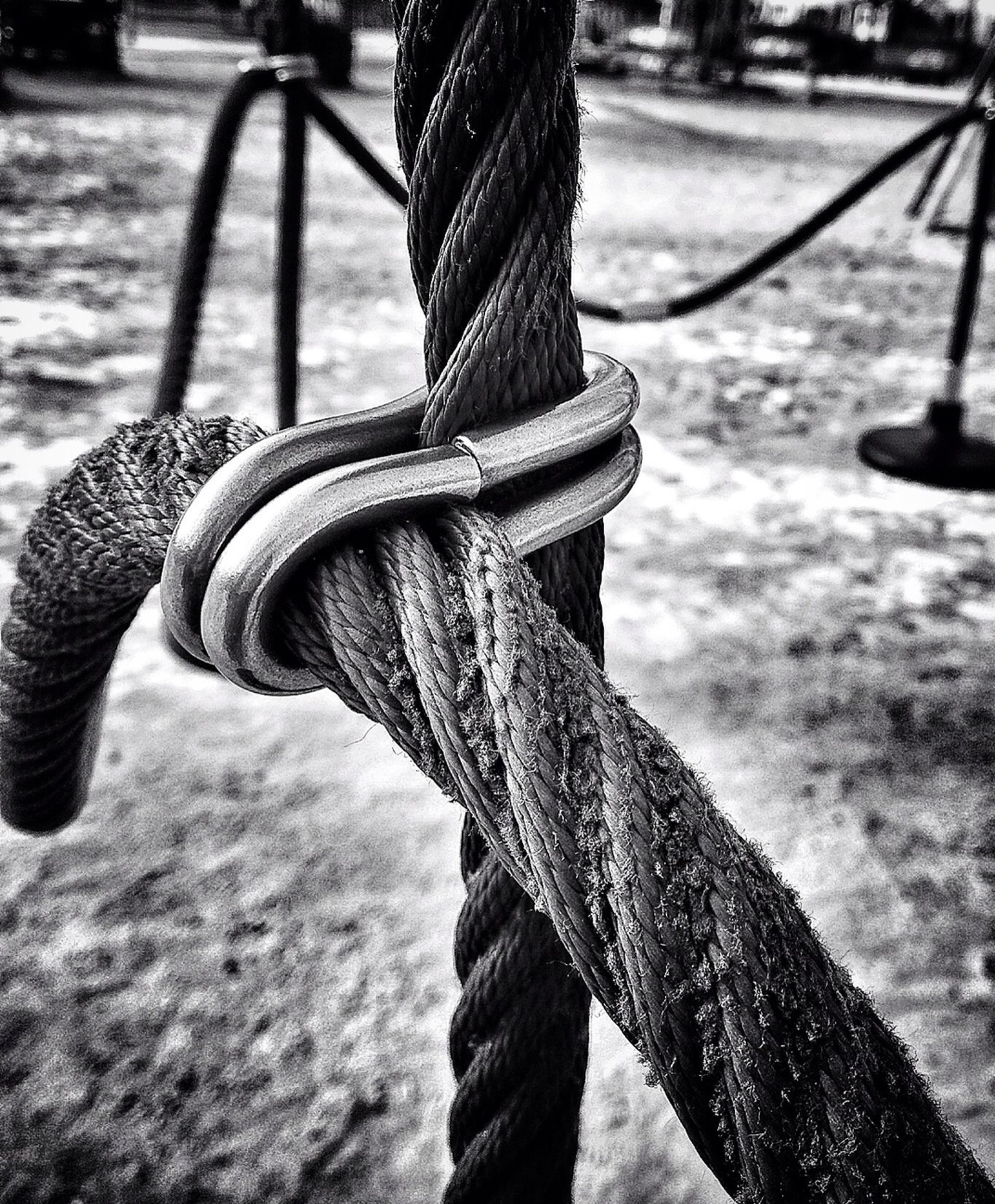 metal, focus on foreground, close-up, metallic, transportation, day, part of, wheel, outdoors, sunlight, strength, rope, no people, connection, river, water, tire, park - man made space, sky, cropped