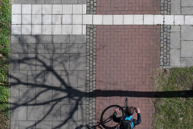 Directly above shot of man riding bicycle