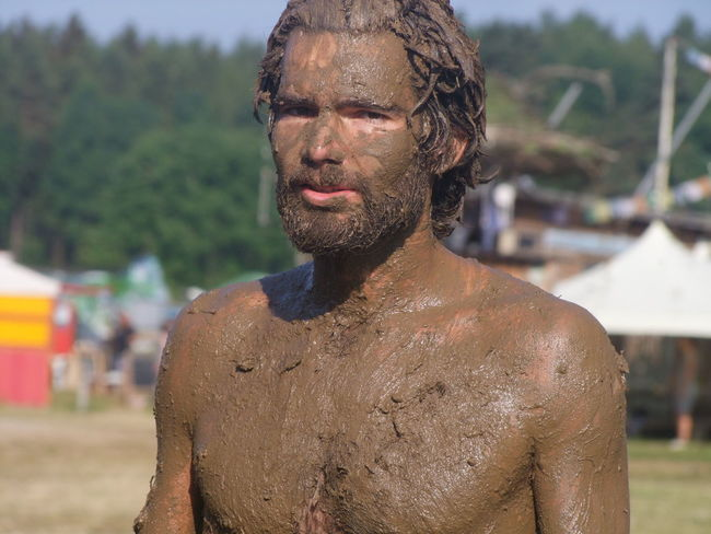 Schlammmensch Adult Beard Chest Close-up Covered In Mud Day Dirty Facial Hair Focus On Foreground Front View Headshot Leisure Activity Men Messy Mud Bath Muddy Nature One Person Outdoors Portrait Real People Shirtless Standing Stubble Waist Up Young Adult