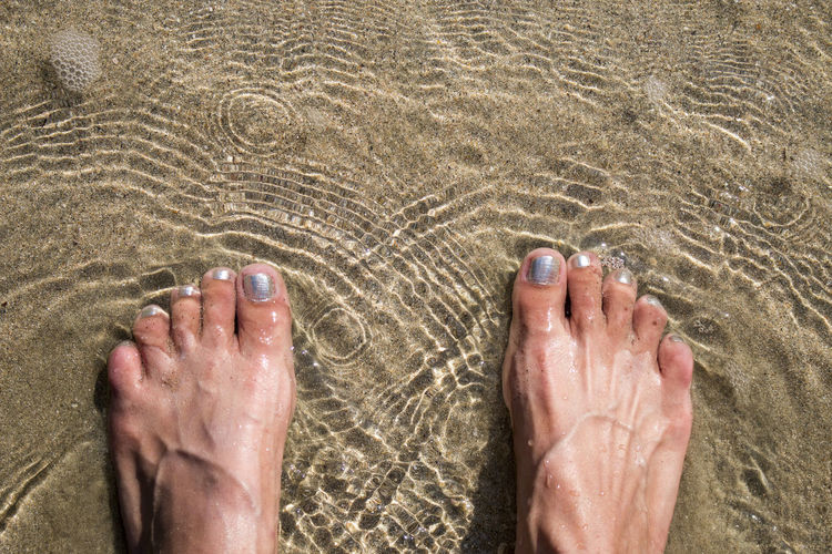 Alone Feet In The Sand Feet In The Water Happiness High Angle View Leisure Activity Low Section Real People Resting Solo Travel Travel Trip Vacation Time Off Holiday Retreat Beach