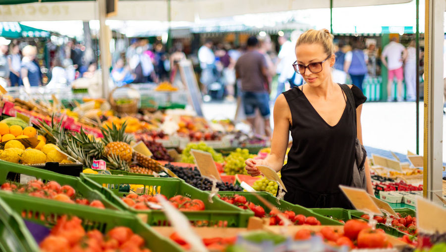 Beautiful woman standing in market