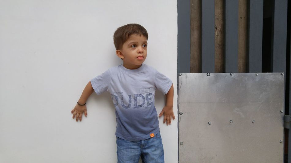 Lifestyles Childhood Standing Leisure Activity Three Quarter Length Casual Clothing Person Elementary Age Looking At Camera Innocence Enjoyment Focus On Foreground Day Dude