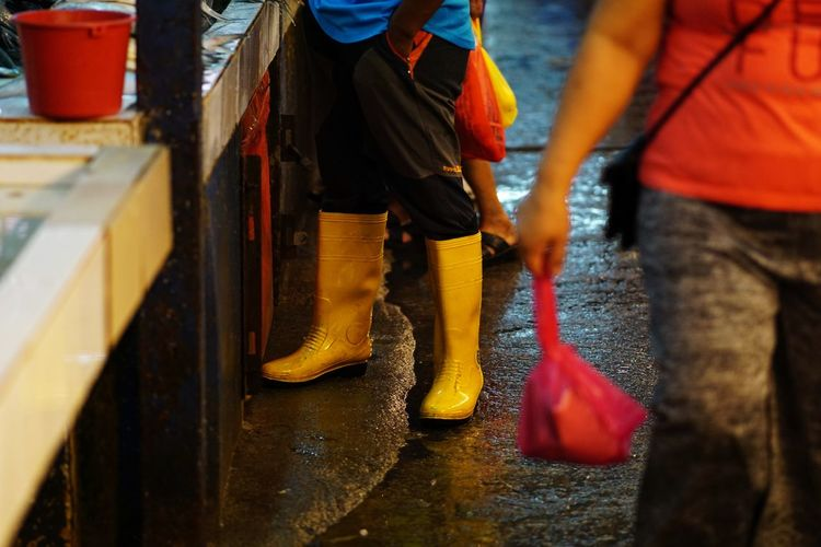Streetphotography Wetmarket Wetmarketscene Yellow Boots Yellow Low Section Occupation Men Human Leg Red Shoe Working Business Finance And Industry City Reflective Clothing Human Foot Foot Sole Of Foot