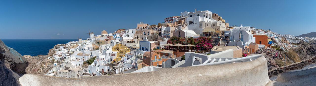 Panorama of Oia village - Santorini Cyclades Island - Aegean sea - Greece Greece Santorino Oia Volcano Caldera Aegean Mediterranean  Cyclades Island Luxury Architecture Building Exterior Built Structure Panoramic Nature Water Building Travel Destinations City Land Residential District Travel Solid Outdoors Apartment