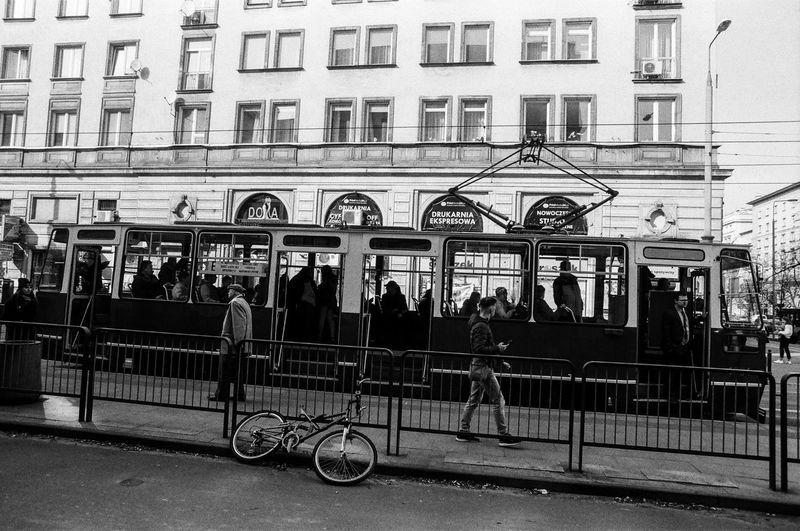 Analog; Nikon FM2 / Ilford PAN 100 The Art Of Street Photography The Week on EyeEm Capture The Moment Everyday Life Nikonphotography Analogue Photography Film Photography Grain Ilford Light And Shadow Warsaw Architecture Built Structure Building Exterior City Group Of People Real People Men Transportation Large Group Of People Women Day Crowd Mode Of Transportation Adult Lifestyles City Life Street Public Transportation Leisure Activity Outdoors Waiting