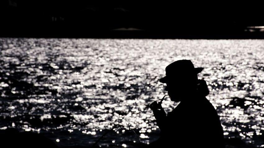 Streetphotography Istanbul EyeEm Street Photography Reflection Silhouettes Street Urban Geometry Urban Urbanphotography Sea Galata Light High Street Minimal Cigarette  Child Childhood Silhouette Standing Photographer Smoking
