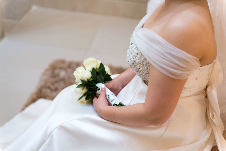 Flower Flowering Plant Midsection Women Adult Bride Life Events Bouquet Plant Flower Arrangement Newlywed Wedding Wedding Dress Event People Lifestyles Clothing Human Body Part Beginnings Nature Positive Emotion Wedding Ceremony Hand Veil Wife