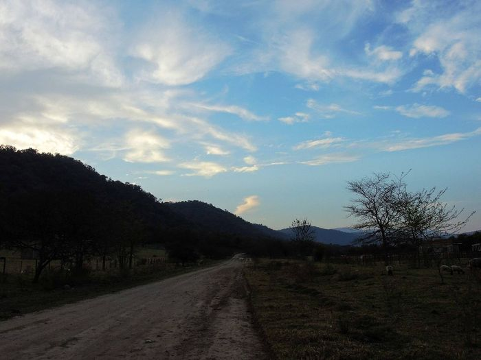 Landscape near to Yerba Buena, Tucumán, Argentina. 2016/09/15. Beauty In Nature Cloud Cloud - Sky Country Road Countryside Day Diminishing Perspective Dirt Road Landscape Long Mountain Narrow Nature No People Non-urban Scene Outdoors Remote Scenics Sky Solitude Surface Level The Way Forward Tranquil Scene Tranquility Vanishing Point