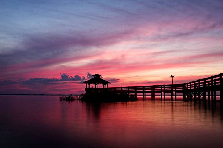 Sunset Sunset Silhouette Sky Built Structure Water Cloud - Sky Architecture Nature Beauty In Nature Sea Outdoors Tranquility Scenics No People Day