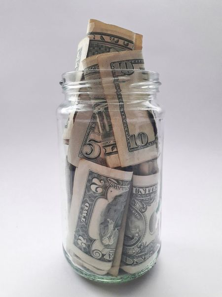Jar full of money dollar bills on white background Dollar Dollars Dollar Bill Dollar Notes Savings Saving Money 1 Dollar Bill 2 Dollar Bill 5 Dollar Bill 10 Dollar Bill Money Moneyshot Finance Wealth Savings Coin Currency Finance And Economy Paper Currency Jar Investment Banking Abundance Retirement No People Studio Shot Close-up Budget White Background Indoors
