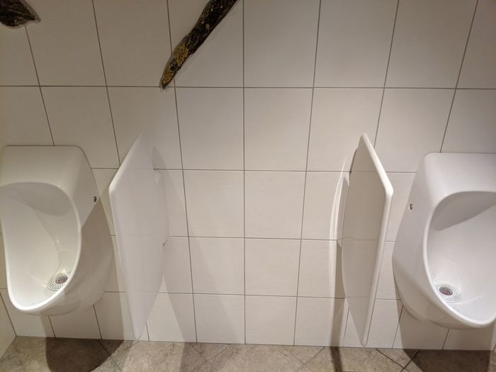 Low angle view of white wall in bathroom