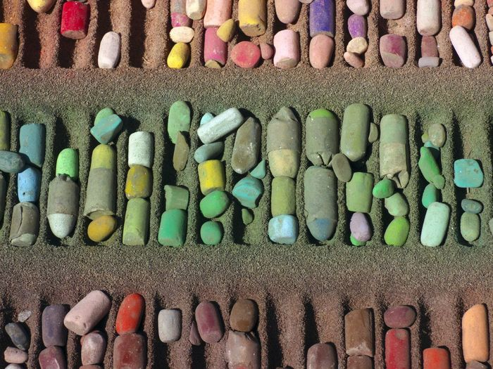 Close-Up Of Multi Colored Chalks In Row