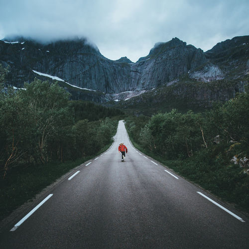 Road Mountain Direction One Person Sky Day Mountain Range Beauty In Nature Nature Lifestyles Scenics - Nature Travel Outdoors Skate Skateboarding Landscape Landscape_Collection Landscape_photography Nature Nature_collection Nature Photography Adventure Norway Travel Travel Destinations