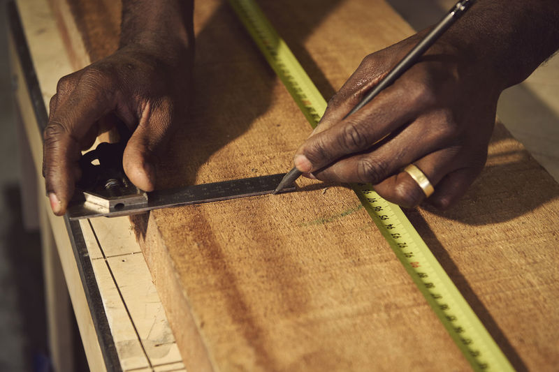 Close-up of man working on cutting board