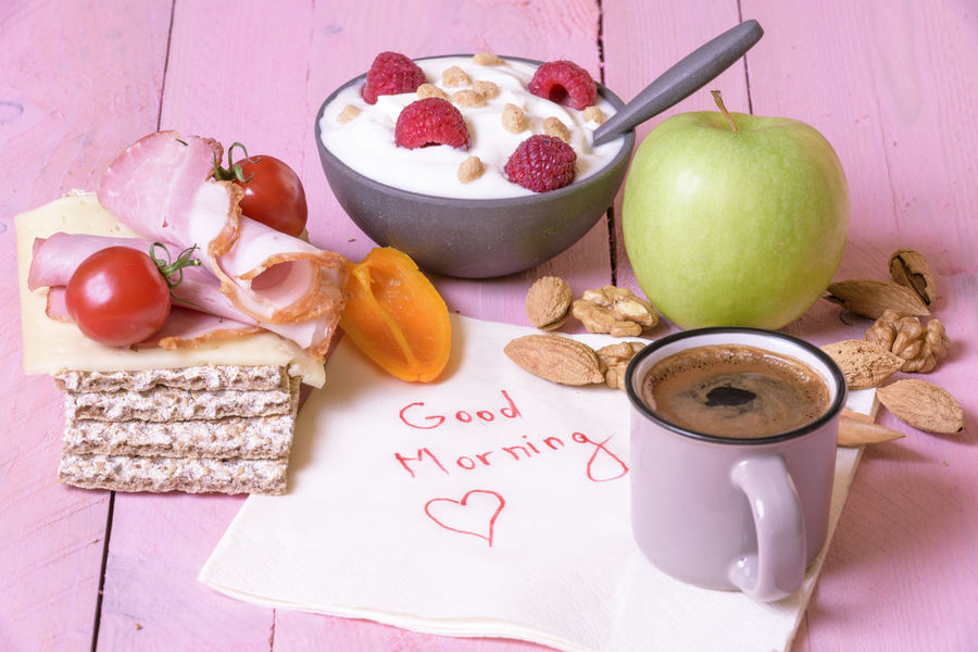 "Healthy breakfast and a small cup of coffee on a white napkin with the message ""good morning"" wrote on it Fruits And Vegetables Breakfast Comunication Crispbread  Cup Of Coffee Food Food And Drink Freshness Fruit Fruit Yogurt Healthy Eating Hot Drink Napkin Message No People Paper Messages Ready-to-eat Text Vegetables"