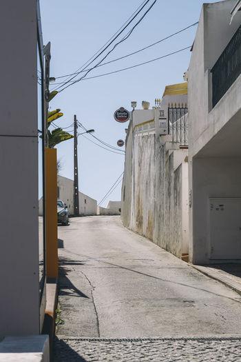 Narrow road along buildings