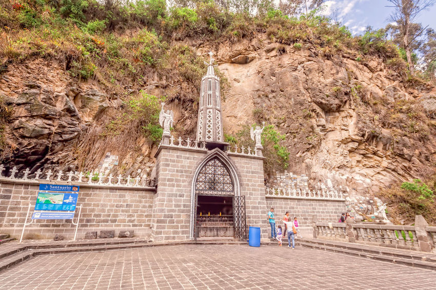 Ipiales, Colombia - 11 September 2016: Las Lajas Sanctuary, Neo-Gothic Gray Stone, Catholic Church Built In A Gorge In Ipiales, Colombia, South America Adult Adults Only Architecture Cathedral Catholic Catholic Church Christianity Church Colombia Day Death Las Lajas Las Lajas Cathedral Life Love Monastery Mountains Outdoors People Pray Praying Sky South America Sunday Tree