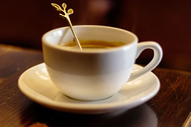 Close-up Coffee - Drink Coffee Cup Cup Day Drink Food And Drink Freshness Frothy Drink Indoors  No People Refreshment Saucer Table