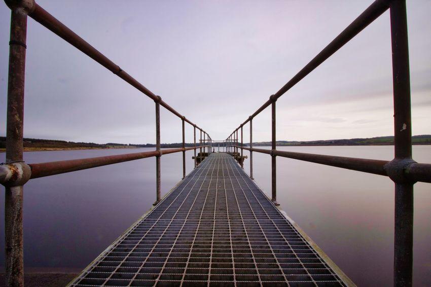Water Symmetry Sea Bridge - Man Made Structure Footbridge City Business Finance And Industry Suspension Bridge Steel Sky Foggy vanishing point The Way Forward