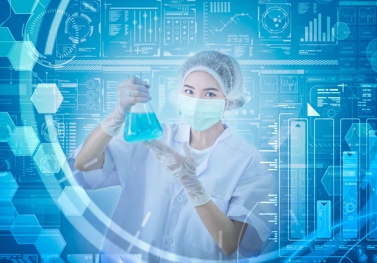 Digital Composite Image Of Scientist Holding Chemical With Various Graphs