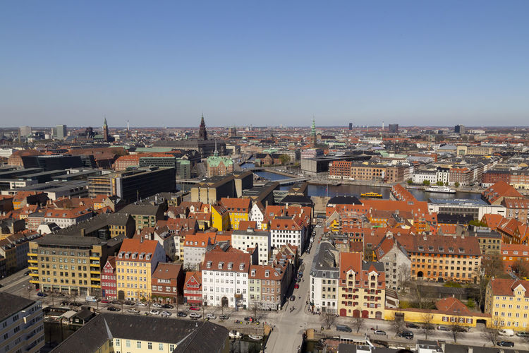 Copenhagen city view from the top Copenhagen Denmark Aerial City Scandinavia View Church Beautiful House Summer Tower Cityscape Danish Day Urban Landscape Skyline Architecture Building Capital Façade Canal Blue Sky Travel Water Europe Street Exterior Horizon Famous Roof Sea Baltic Downtown Panorama Colorful Campanile BIG Green