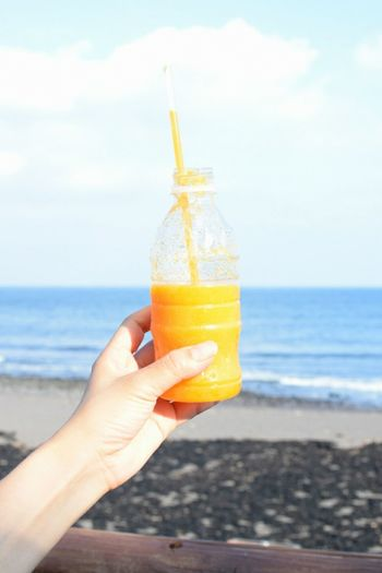 Juice Food And Drink Lifestyles Vacations Sky Drinking Straw Person Summer Drink Outdoors Refreshment Sea Horizon Over Water First Eyeem Photo