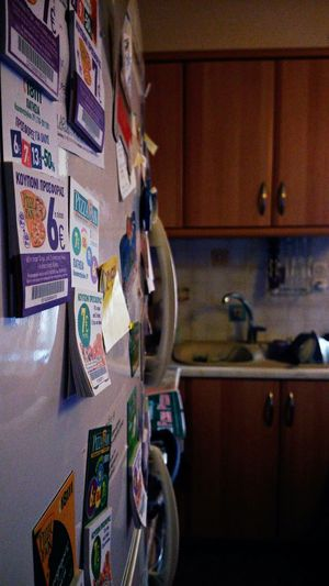 Fridge Door Fridge Magnets Discount Coupons Delivery Kitchen Focus On Foreground Light And Shadow