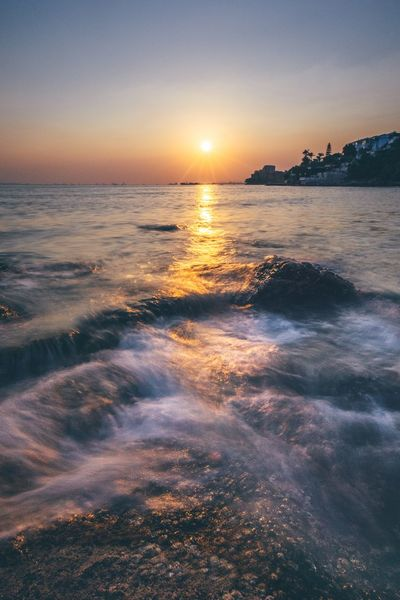 Sky Water Sea Sunset Scenics - Nature Beauty In Nature Beach Tranquility Reflection Horizon Over Water Nature Sun Sunlight Outdoors
