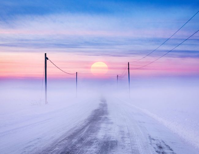 Beauty In Nature Cold Temperature Colorful Colorful Sky Horizon Idyllic No People Outdoors Power Lines Against Sky Power Supply Road Scenics - Nature Sky Sun Sunset The Way Forward Tranquil Scene Tranquility