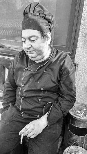 Full length portrait of man sitting outdoors